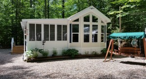 The attractive park model cottage for sale in Lake Forest Resort, NH.