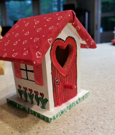 I added a window and some shutters to the birdhouse.