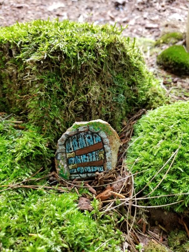 fairy door painted on a rock
